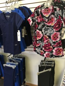 floral nurses uniform on clothing rack in shop