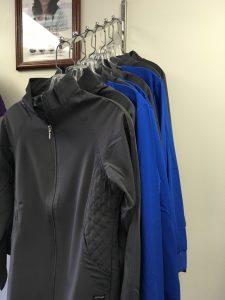 gray and blue fleece jackets